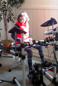 Young Girl Playing Electric Drum Set